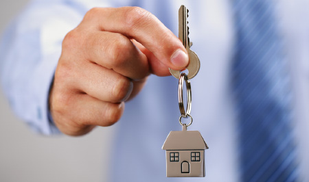 Man handing over house keyring